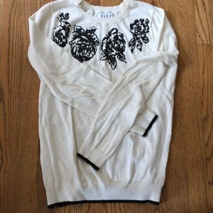 Sweater with black rose shaped beading